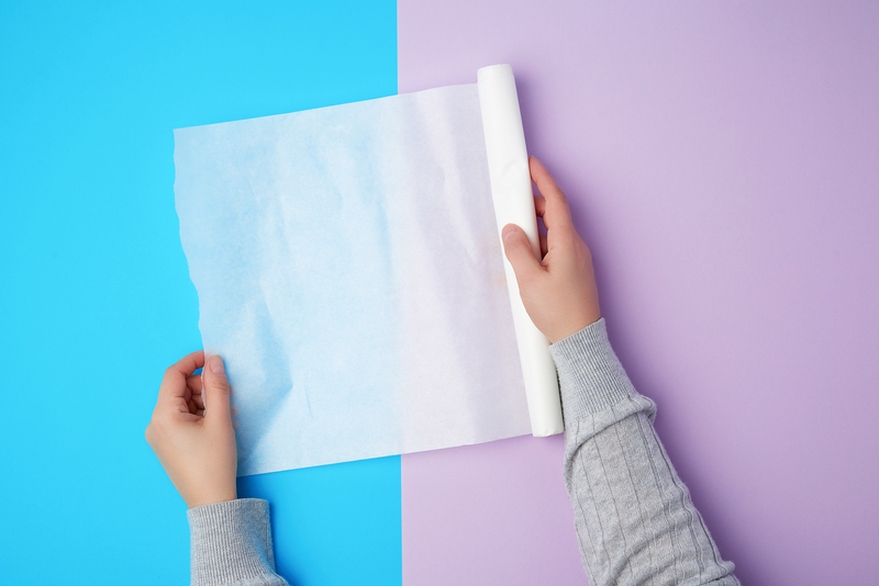 Cover the transfer paper using the paper backing, or use a soft kitchen towel.